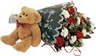 Attractive wrapped bouquet of fresh flowers including red roses with white carnations and baby's breath. This item comes with an added teddy bear. Please note that teddy may vary according to delivery region.
